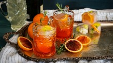 Aperol spritz with champagne, blood orange and rosemary.