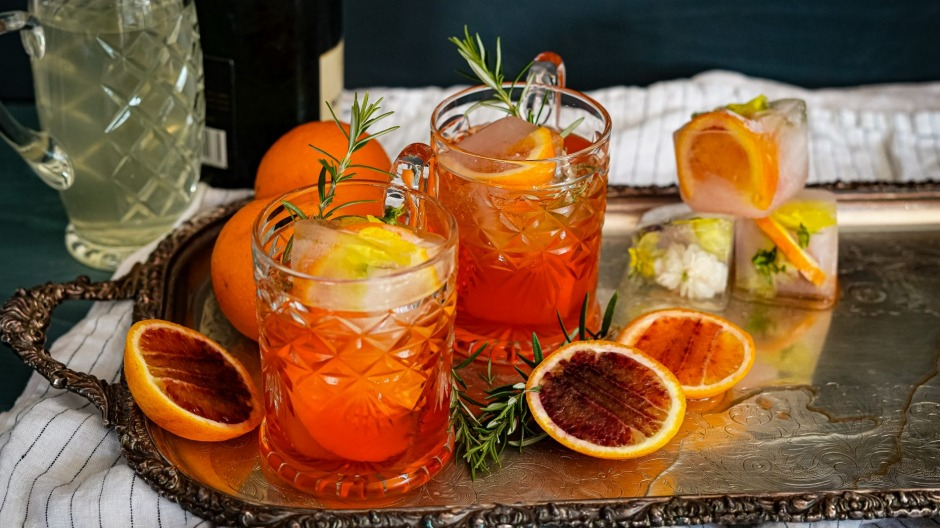 Aperol spritzes with optional fruit-filled ice cubes.
