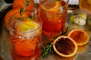 Aperol spritz with champagne and rosemary.
