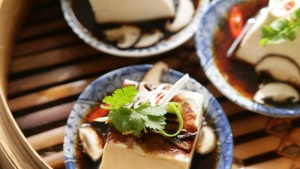 Aromatic steamed silken tofu squares.