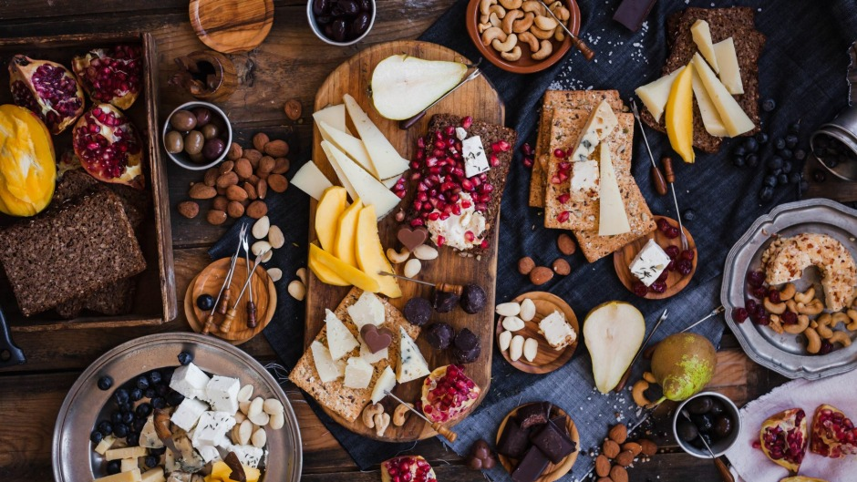 Displaying cheese in slices with fruits and nuts is equally pretty and practical for grazing guests.