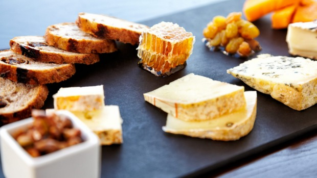 Honey and nuts complement the flavours on a cheese platter.