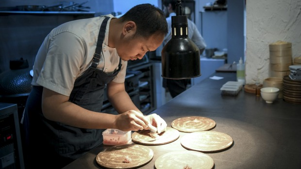 Chef-owner Mo Zhou plating up.