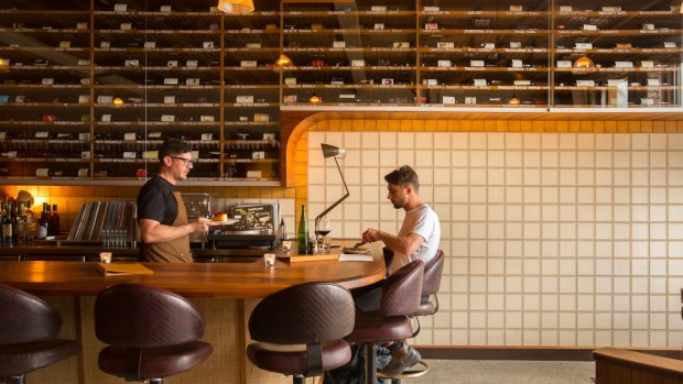 The 300-plus wine selection dominates the bar.