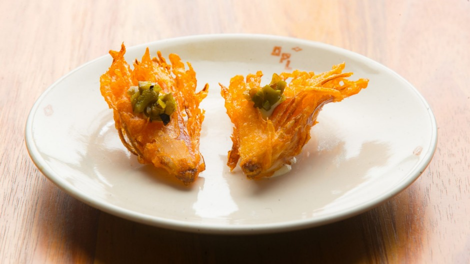 Like a bloomin' onion in miniature: fried shallot with jalapeno cashew sour cream