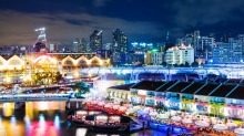 ​The bright lights of riverside Clarke Quay.