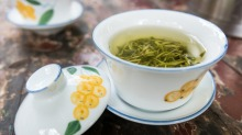 Steeping longjing tea at the traditional teahouse in Wenshu Temple, Chengdu, China.