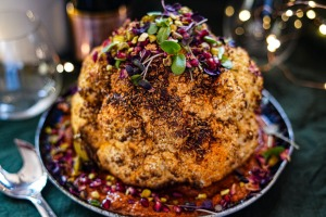 Slow-roasted spiced cauliflower with romesco and herbs.