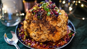 Christmas centrepiece: Whole-roasted spice-rubbed cauliflower sitting on romesco.