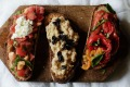 From left: Bruschetta with tomatoes mint and ricotta; cannellini beans, black olives and salami; peppers, capers and basil.