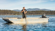 Shane Buckley collects certified organic native Sydney rock oysters from Wapengo Lake.