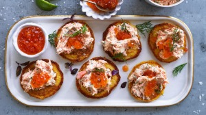 Corn blinis with salmon rilletes.