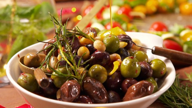 Warm olives with macadamias and chilli