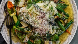 Zucchini showered with pecorino cheese and sumac.