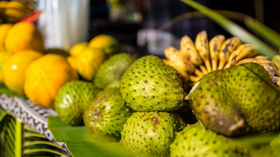 Soursop (foreground), bananas and papaya at Punanga Nui Market, Aitutaki, Cook Islands.