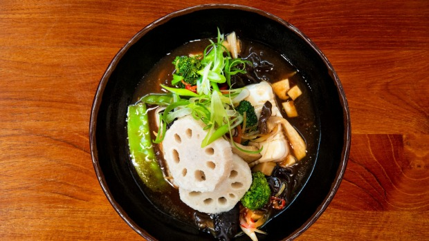 Tofu stir-fry with lotus root, snow peas and king oyster mushroom at Red Spice Road.