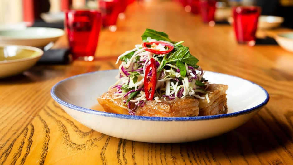 Red Spice Road's signature pork belly with hot mint slaw, black vinegar and chilli caramel.