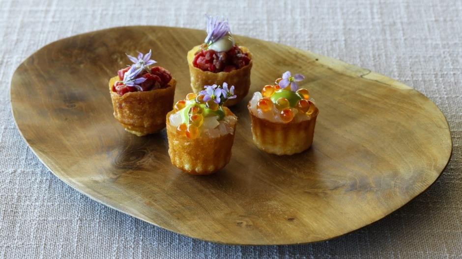 Pie tee shells of carrot waste filled with delicately smoked salmon.