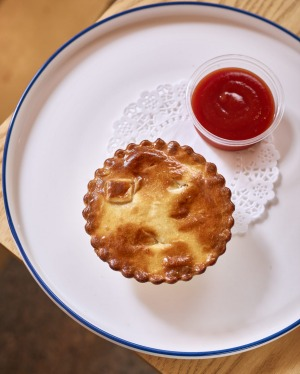 The meat pie and tomato sauce is no longer Australia's national dish.