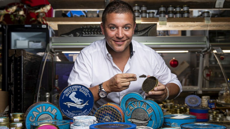 Gourmet food importer and owner of Gourmet Life, Josh Rea, with his collection of caviar.