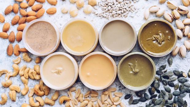 Homemade nut and seed butters including peanut, almond, hazlenut, cashew, pistachio, macadamia nuts and sunflower seeds.