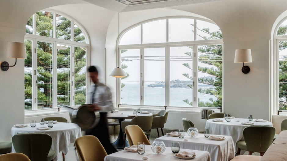 Mimi's restaurant looks through coastal pines to the ocean.