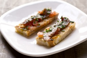 Anchovy with tomato and garlic on grilled bread