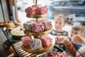 Classic and Davidson's plum jam lamingtons at Phillippa's bakery-cafe in Armadale.