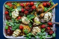 Zucchini cheese parcels with tomatoes and fresh herbs.