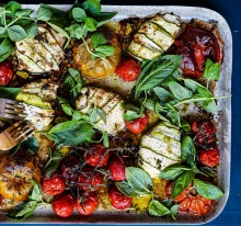 Zucchini wrapped cheese with tomatoes and fresh herbs. Summer traybake recipes and sheetpan dinners for Good Food, ...