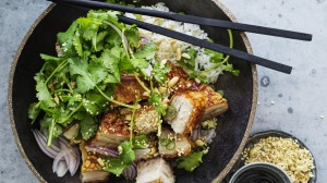 Crispy pork belly with coriander, peanuts and red onion salad.