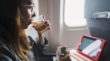 Don't bring egg or tuna sandwiches on board - and always disinfect your tray table.