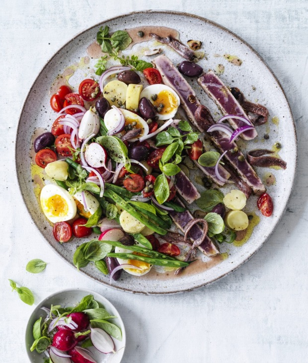 Never toss a nicoise - ingredients should be composed with an eye for colour and contrast.