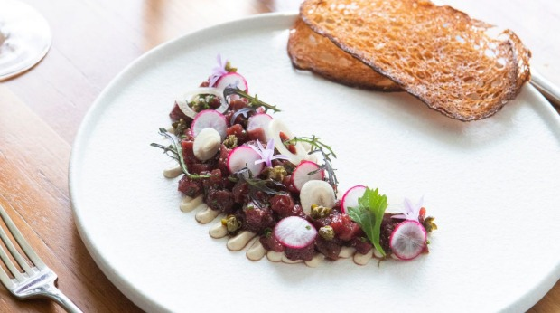 Highly seasoned kangaroo tartare is a sort of reverse Aussie vitello tonnato.