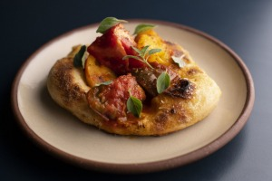 Go-to dish: Catalan coca, featuring tomatoes on a springy sourdough base.