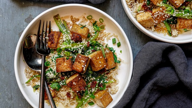 Maple, soy and sesame tofu stir-fry with brown rice and greens. Sticky stir-fries for Good Food, February 2019. Images and recipes by Katrina Meynink. Good Food use only.