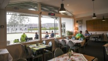 Lorne Bowls Club's dining room has an op-shoppy aesthetic.