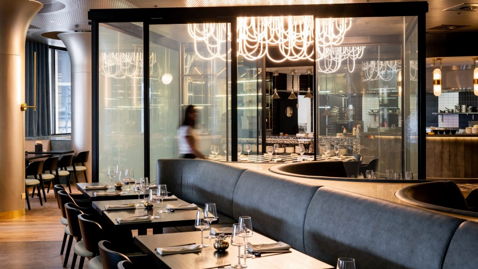 The glass private dining room at Yugo becomes opaque at the push of a button.