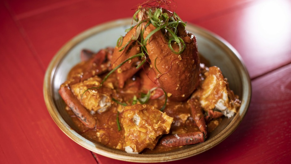 The chilli crab is cooked over high heat until the flesh is velvety, with broken shells for easier eating and saucing.