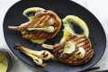 Barbecued pork chops with lemon garlic sauce and pickled spring onions.