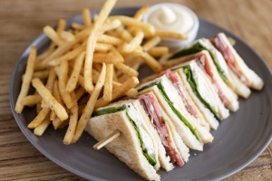 A nod to the past: Truffled chicken club sandwich with fries.
