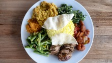 Load up your plate with a selection of curries, rice, vegies and other dishes.