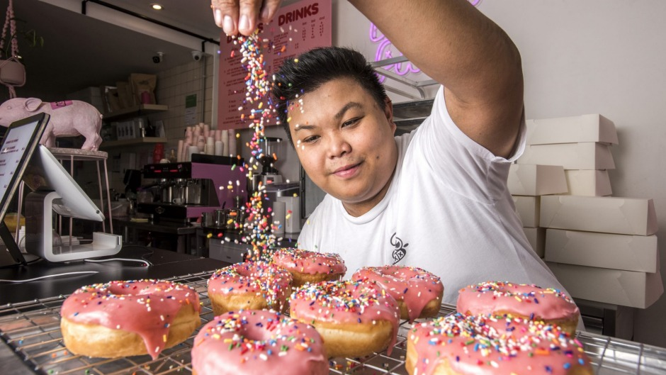 Kenneth Rodrigueza is happy not to throw out his doughnuts.