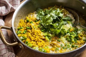 Throw together a quick curried rice with frozen peas and pantry spices.