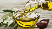 Extra virgin olive oils have healthy antioxidants such as biphenols, that catch on the back of the throat.
