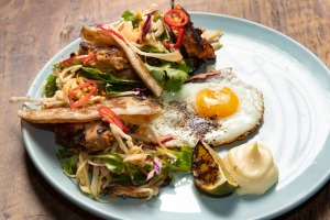 Balinese-style chicken with apple slaw and roti.