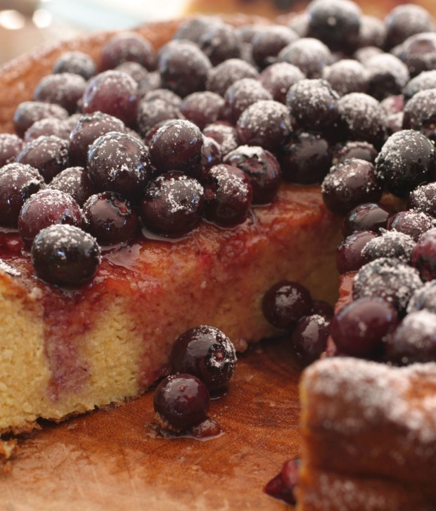 Orange and almond cake topped with blueberry compote.