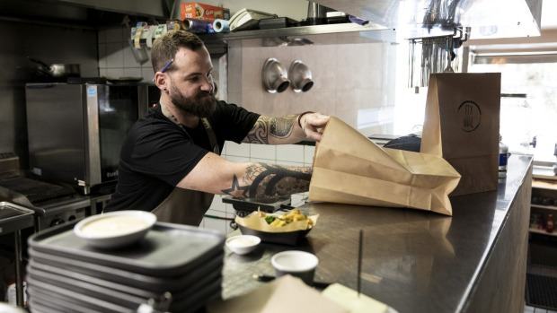 Chef Mark Archer prepares takeaway meals at Fix Wine Bar and Restaurant.