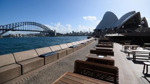 Empty tables at the Opera Bar restaurant in Sydney.