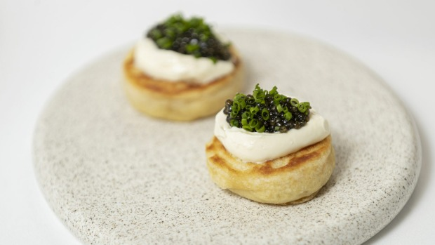 Caviar and creme fraiche on crumpets.